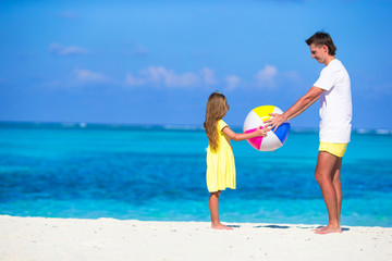 Happy father and daughter playing with ball having fun together