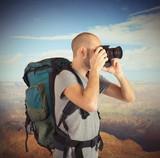 Explorer photographing landscapes