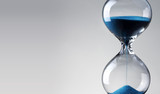 Fototapety Time passing. Blue hourglass.