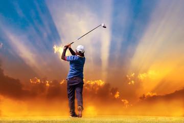 golfer hit golf ball on sunbeams background with fog