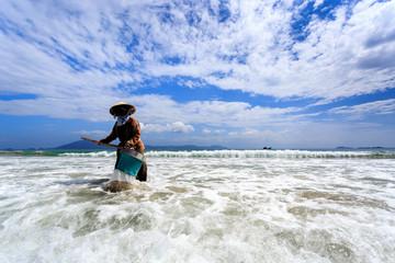 Unknown Sanitation Worker Cleaning Doc Let Beach, Vietnam