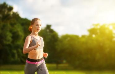 woman jogs runs on nature