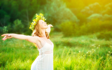 happy woman in wreath  summer enjoying life opening hands