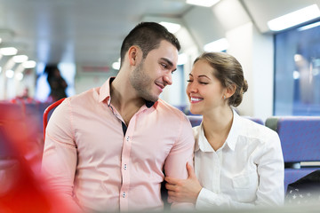 Man and woman travel in train