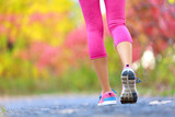 Jogging and running woman with athletic legs