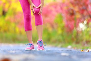 Knee Injury - running sport knee injuries on woman