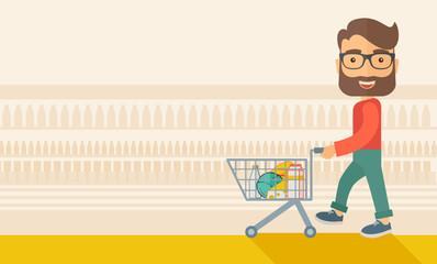 Male Shopper Pushing a Shopping Cart.
