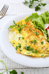 Omelette with herbs on plate