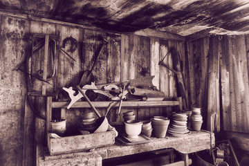 old barn 17th century with tools, pots and pans, vintage effect.