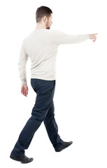 Back view of going  handsome man in jeans pointing