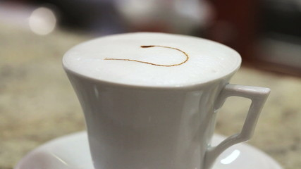 Drawing a heart on the surface of the froth