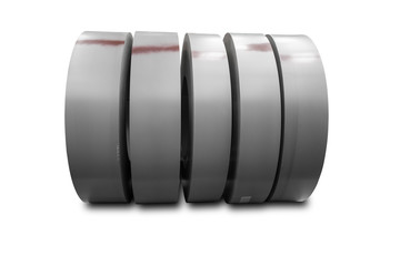 Rolls of metal sheet on white