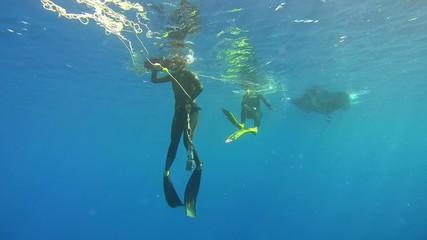 Freedivers set buoy, Red Sea, Egypt
