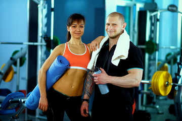 Bodybuilding. Strong man and a woman posing