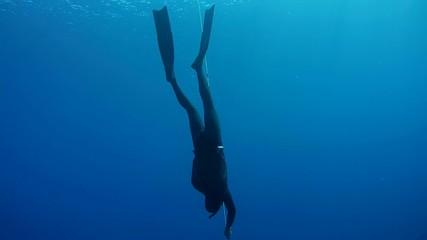Freediver descends to a Red Sea, Egypt