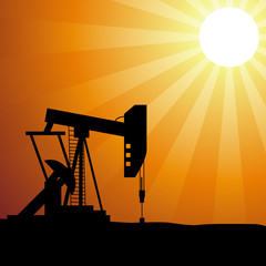 Oil well silhouette on sunset