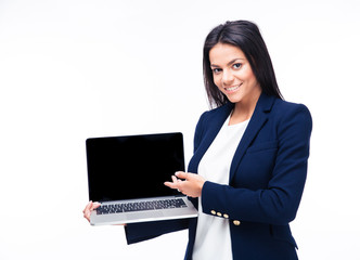 Happy businesswoman showing blank laptop screen