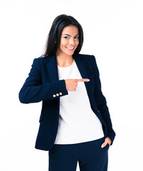 Cheerful young businesswoman pointing finger away