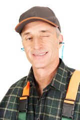 Mature worker blinks his eye