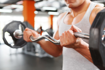 Close up of weightlifter with barbell