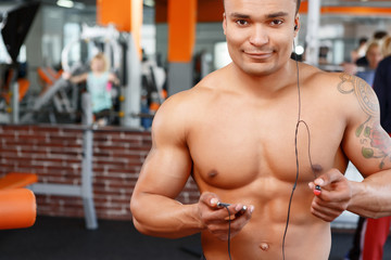 Sport is pleasure. man in gym
