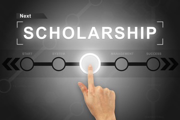 hand clicking scholarship button on a screen interface