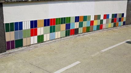 colorful tile of sidewall along a road