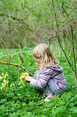 girl picking cowslip flower