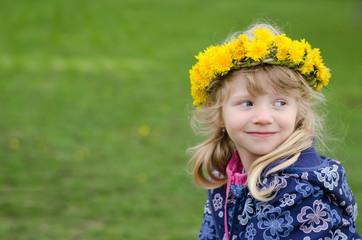 beautiful girl with dandelion flowers over head