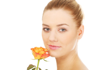 Smiling woman with fresh rose.