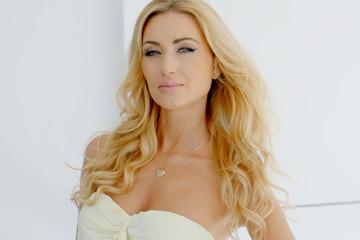 Blond Woman Wearing Strapless Dress