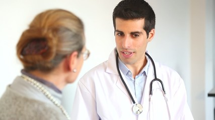 A doctor talks with a female patient