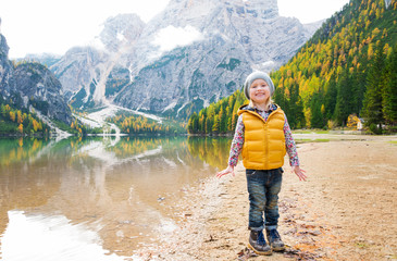 Blonde girl standing on the shore of Lake Bries