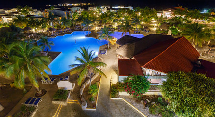 View on hotel and swimming pool at night