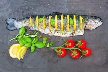 lemon stuffed whole trout with spices on the tray