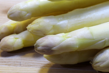 mature white asparagus tips for sale from greengrocers in spring