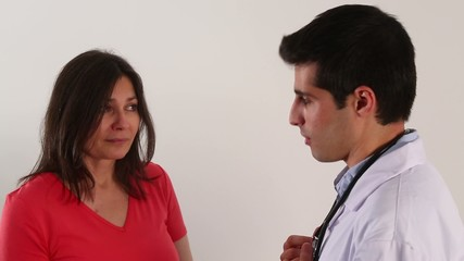 A young doctor is talking with a female patient