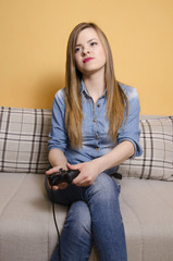 Cute girl playing video games