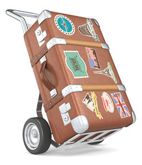 Retro suitcase with retro travel stickers on a trolley.