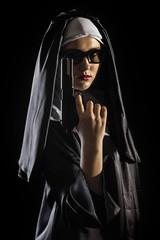 Nun with handgun