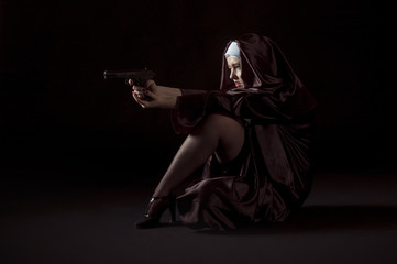 Young nun shoting from gun