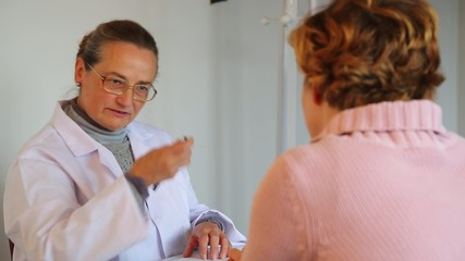 A female experienced doctor prescribes a medical treatment
