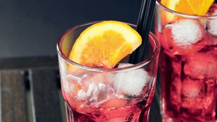 pouring red spritz aperitif aperol cocktail with orange slices
