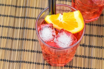 top of view of spritz aperitif cocktail and orange and ice