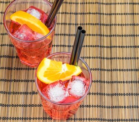 spritz aperitif aperol cocktail and orange slices and ice