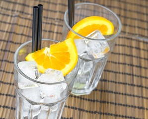 top of view of empty cocktail glasses with orange slices and ice