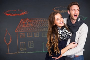 Composite image of happy young couple embracing