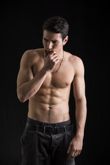 Wondering handsome shirtless young man thinking unsure