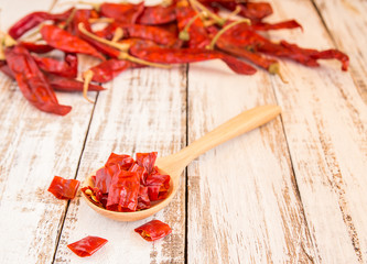 Dried chili peppers on wooden background