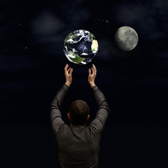 man holds the planet